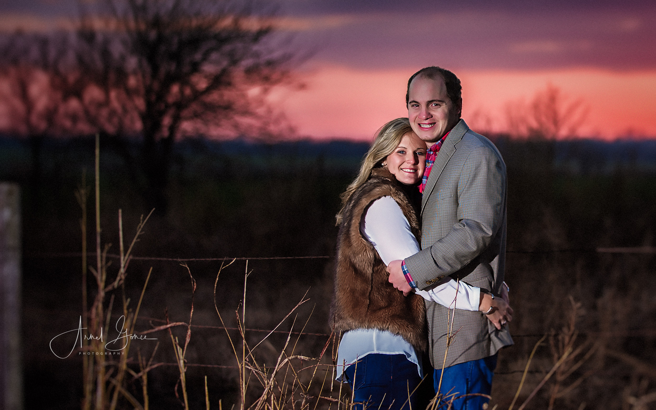 Newly engaged couple at sunset during their engagement photography session in Oklahoma.